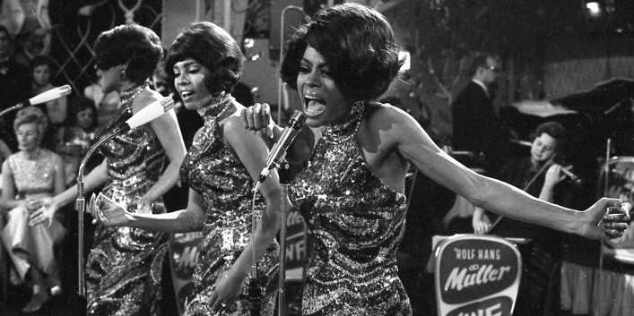 "The Supremes with Diana Ross, front, Cindy Birdsong and Mary Wilson sing and dance during their performance at the anual ""Bal pare"" party in Munich, West Germany, January 21, 1968. The U.S. American singing trio was backed by the West German Rolf Hans Mueller big band and were celebrated with thundring applause. (AP Photo/Frings)"
