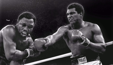 FILE--Spray flies from the head of challenger Joe Frazier as heavyweight champion Muhammad Ali connects with a right in the ninth round of their title fight in Manila, Philippines, October 1, 1975. Ali won the fight on a decision to retain the title. Frazier was arrested for drunken driving early Tuesday morning, April 7, 1998, after being pulled over for driving erratically down a North Philadelphia street. The ex-boxer, who also runs Joe Frazier's Gym in Philadelphia, was later taken to Thomas Jefferson University Hospital after complaining of problems related to his high-blood pressure, authorities said. (AP Photo/Mitsunori Chigita)