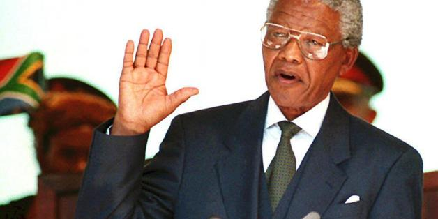 "(FILES) A file photo showsing South African President Nelson Mandela taking the oath 10 May 1994 during his inauguration at the Union Building in Pretoria. South Africa's newly-elected parliament will be treated to some ""Madiba Magic"" 10 May 2004 when national icon Nelson Mandela delivers a special address to mark a decade of freedom. Mandela, affectionately known by his clan name Madiba, will address a joint sitting of parliament in Cape Town 10 years to the day after he was inaugurated as South Africa's first black president on May 10, 1994. (Photo credit should read WALTER DHLADHLA/AFP/GettyImages)"